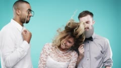 Drunk blonde woman dancing with loser men slow motion party photo booth Stock Footage