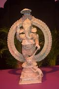 Old statuette  of Hindu god of wisdom, knowledge and new beginnings Ganesha - stock photo