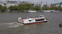 Passenger boats on river Thames in London Stock Footage