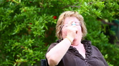 senior woman using asthma inhaler - stock footage