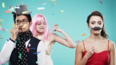 Three attractive friends dancing at party confetti shower slow motion photo - stock footage