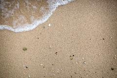 Closeup  sand and mini wave - stock photo