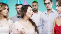 Geek girl dancing for group of people slow motion party photo booth Stock Footage