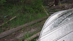 Over turned boat on trail Stock Footage