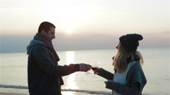 Young beautiful enamored couple having warming drinks and enjoying the marvelous Stock Footage