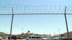 San Antonio Skyline scene behind Prison Fence with Razor Wire Stock Footage