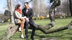 Couple relaxing in park Stock Footage
