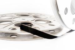 Vintage 35 mm movie film cinema reel on white - stock photo