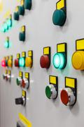 electrical panel with multi-colored indicators - stock photo