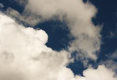 Thick white cloud in the blue sky Stock Photos