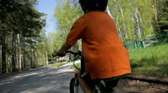 Little child riding a bike in helmet in spring. Stock Footage