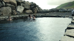 Friends Soak in a Hot Spring on Grettislaug, ICELAND - stock footage
