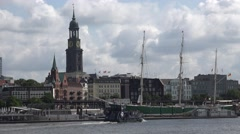 ULTRA HD 4K Touristic boat Hamburg skyline cathedral tower iconic landmark icon  Stock Footage