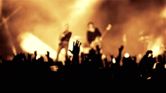 Rock guitarist band on open air live music show cheering crowd in illumination Stock Footage