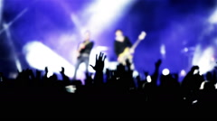 Rock guitarist band on open air live music show cheering crowd in illumination - stock footage