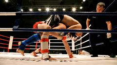 Professional boxer knock out his rival during a boxing match Stock Footage