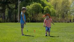 children playing mini golf in the park - stock footage