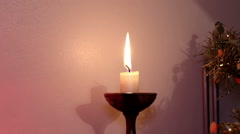 Lit Candle in a candlestick - stock footage