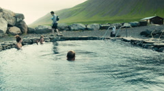 People Soak in Hot Spring on Grettislaug, ICELAND - stock footage