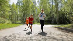Active family - mother and kids running outdoor - stock footage