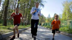 Mother with kids running outdoor - stock footage