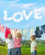 Cute brothers making a laundry - stock photo