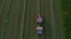 Aerial, vertical - Tractor collecting dried grass Stock Footage