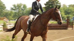 Hunter Jumper Cantering Through Course Stock Footage