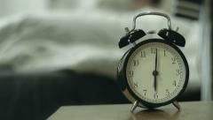 Woman and dog waking up by alarm clock Stock Footage