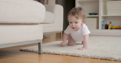 Little toddler crouching - stock footage