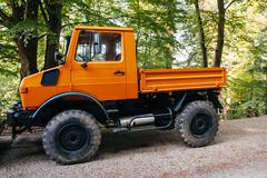 Unimog four wheel drive vehicle as seen on a forest road. - stock photo
