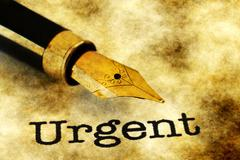 Urgent and fountain pen Stock Photos