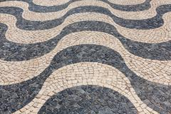 Typical portuguese cobblestone hand-made pavement calçada in Lisbon, Portuga Stock Photos