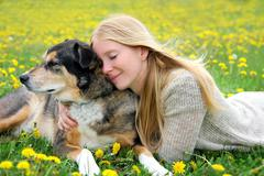 Woman Tenderly Hugging German Shepherd Dog - stock photo