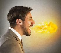 Stock Photo of Businessman spits fire