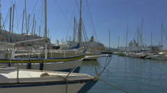 Boats rock in marina cruiseship sailboat warship background - 4K UHD 0784 Stock Footage