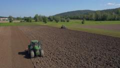 Aerial - Tractors doing primary and secondary tillage Stock Footage