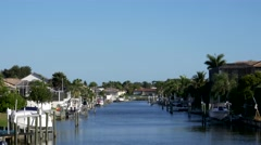 Waterfront homes on canal, 4K Stock Footage