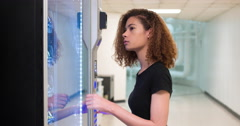Women purchasing snack from vending machine 4k Stock Footage