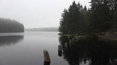 Oderteich lake at rainy season in Harz forest panning - stock footage