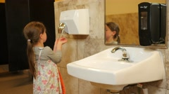 Girl drying hands Stock Footage