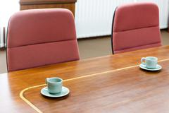Empty tea cup in meeting room Stock Photos