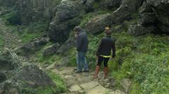 Friends Hike through Canyon in Þingvellir National Park Stock Footage