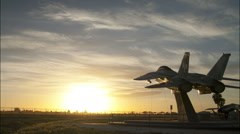 USA Navy F-14 Tomcat at sunset Stock Footage