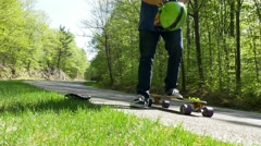 Long Boarder puts on helmet Stock Footage
