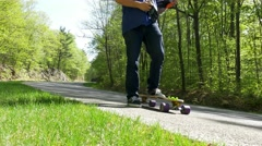 Long Boarder puts on gloves Stock Footage