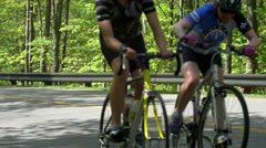 Female cyclists exercising in Gatineau Park- Editorial Stock Footage