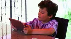Little cute boy using tablet Stock Footage