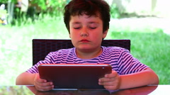 Little cute child using tablet Stock Footage