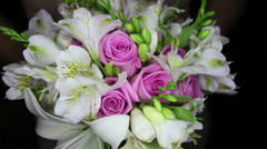 Bouquet with white lilies and pink roses Stock Footage